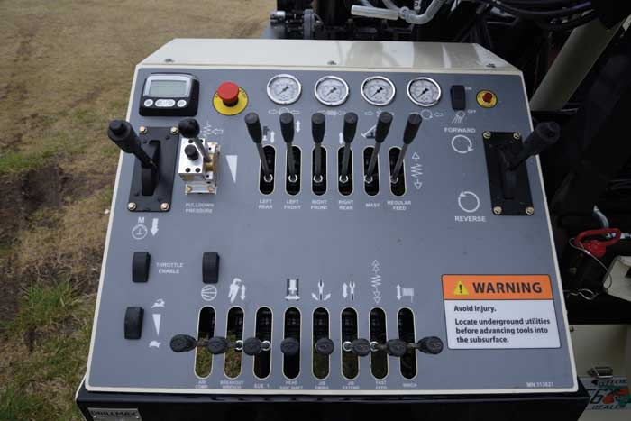 The neatly laid out DM250 control panel with engine gauge, E-stop, hydraulic pressure gauges, friction control levers for mud pump and rotation circuits, and electronic throttle controls make the DM250 simple and safe to operate.